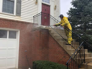 A picture of a person doing residential pressure cleaning