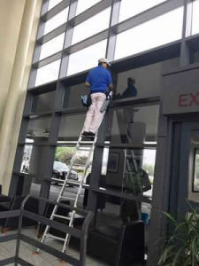 A person doing commercial window cleaning